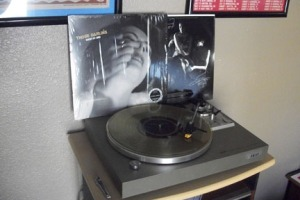 My brand new copy of Screws Get Loose by Those Darlins on translucent gold vinyl on the turntable.
