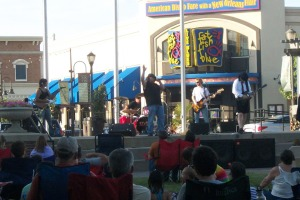 KC/DC performing live at the Zona Rosa Town Square on 7/14/12.