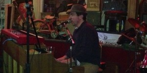 Andy Grroms tickles the piano keys at Magoon's in St. Joseph, MO on 1/10/13.