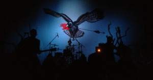 The Airborne Toxic Event uses their backdrop to their full advantage at Liberty Hall in Lawrence.