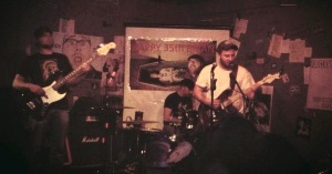 Dsoedean busting through their opening set at Cafe Acoustic on 4/13/13. Left to right: Colby Walter, Bobby Floyd and Zale Bledsoe.