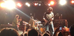 Mike Cooley solos during a Drive-By Truckers song at The Crossroads in Kansas City, Missouri on 5/25/13 with Patterson Hood, Matt Patton and The EZB in the background.