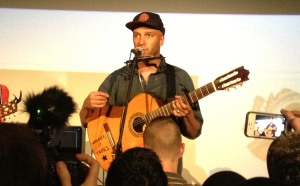 Tom Morello performs some acoustic songs in the Alamo Draft Movie Theater at a benefit for Tomas Young.