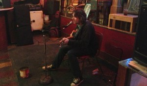 Songwriter Tracy Huffman raids his songbook at a weekly show at Magoon's in St. Joseph, Missouri.