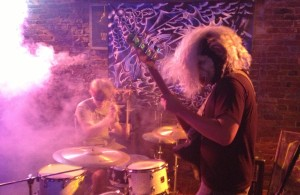 Nashville, Tennessee band Megajoos do some head banging during their high-intensity show at The First Ward in St. Joseph, Missouri on 7/12/13. There were better pictures of them but this action shot clearly depicted them in a way that better represented what happened on stage.