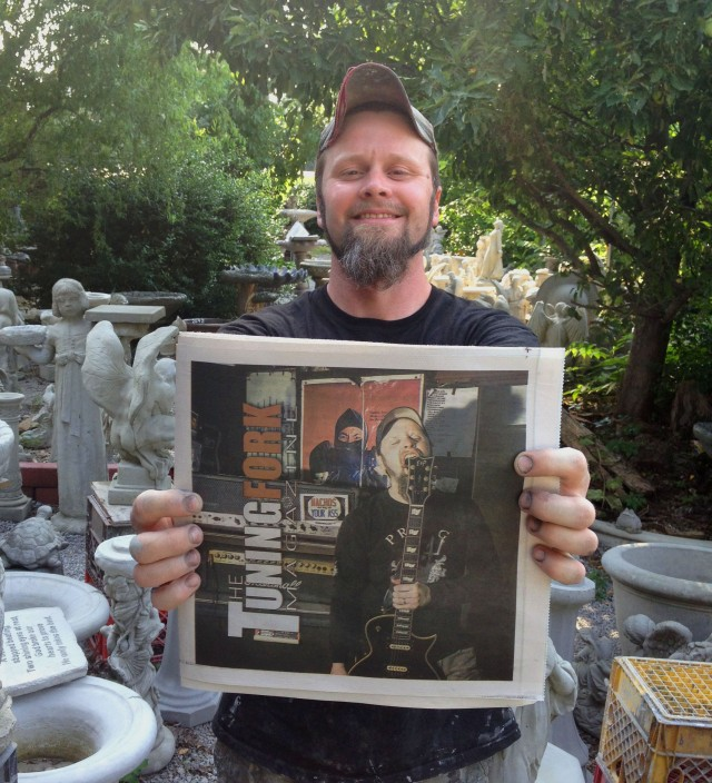 Todd Cooper posing with the very first distributed issue of Tuning Fork Magazine. He got a copy before anyone else; he deserved it.