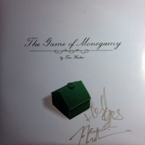 "An autographed copy of the solo debut from Tim Kasher ""The Game of Monogamy"" on vinyl obtained at the living room show in Kansas City, MO."