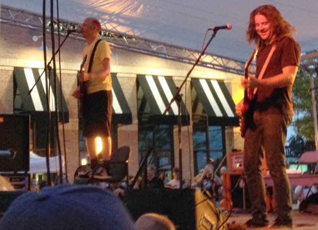 """The Presidents of the United States of America perfroming live at the Sunset Music Fest at Town Center Plaza in Leawood, Kansas. Lead singer Chris Ballew (left) performs their song """"Dune Buggy"""" from on top of a chair simply because he is a rock star and can do that sort of thing."""