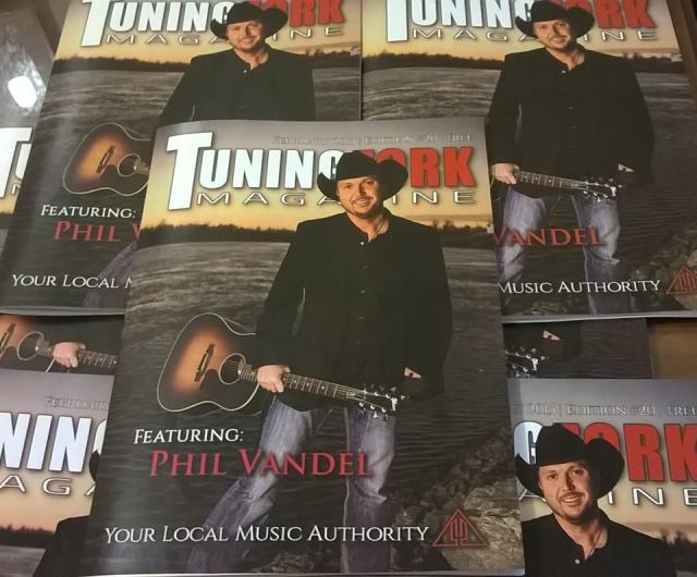 A stack of the Tuning Fork Magazine Phil Vandel was on the cover of in February 2015. Cover photo by Heather Kirchhoff