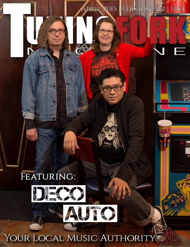 """Deco Auto (Steven Garcia, Pat Tomek and Tracey Flowers) on the cover of Tuning Fork Magazine cover for April 2015. The power pop punk trio released their debut full length album """"The Curse of Deco Auto"""" in early 2015."""